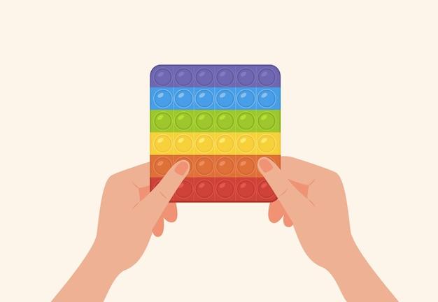 Изолированные вектор pop it toy популярный непоседа, держа в руках игрушка-антистресс