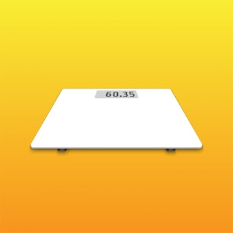 Isolated white weighing scale on orange background