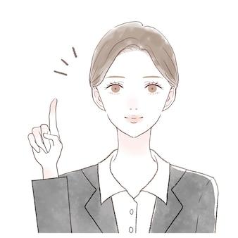 指を指さしながら説明する女性社員です。