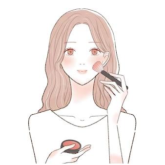 Это женщина, которая красит румянец на щеке кисточкой для макияжа.