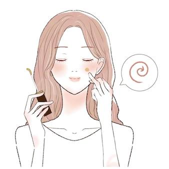 컨실러를 얼굴에 바르고 손가락으로 블렌딩하는 여성입니다.