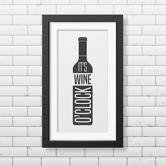 It is wine o clock - quote typography   in realistic square black frame on the brick wall