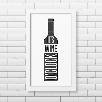 It is wine o clock - quote typography   in realistic square white frame on the brick wall