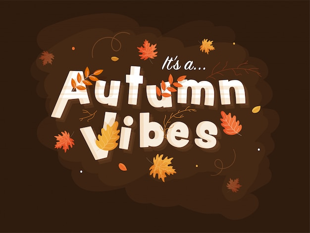 It's a autumn vibes text decorated with leaves on brown background.