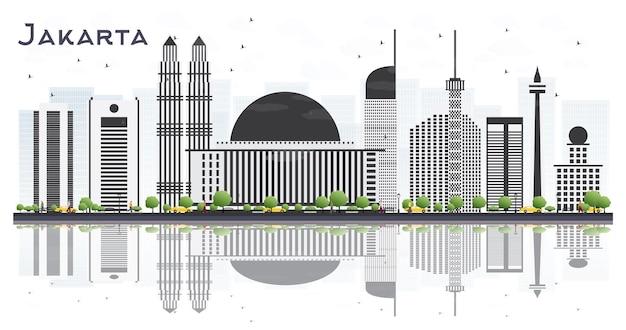 灰色の建物と白い背景で隔離の反射とジャカルタインドネシアの街のスカイライン