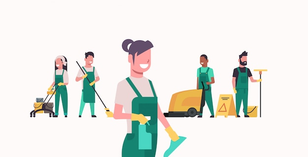 Janitors team cleaning service male female cleaners in uniform working together with professional equipment