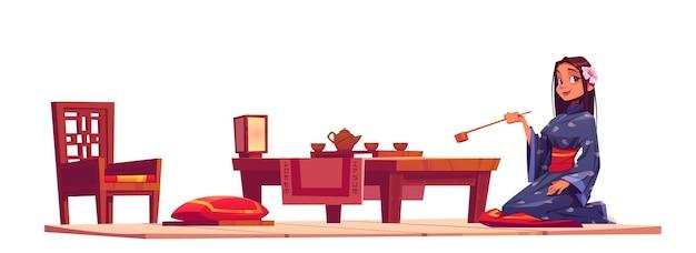 日本の茶道。中国のリビングルームの着物と伝統的な木製家具の女の子。
