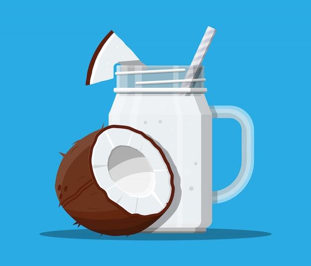 Jar with coconut smoothie with striped straw.