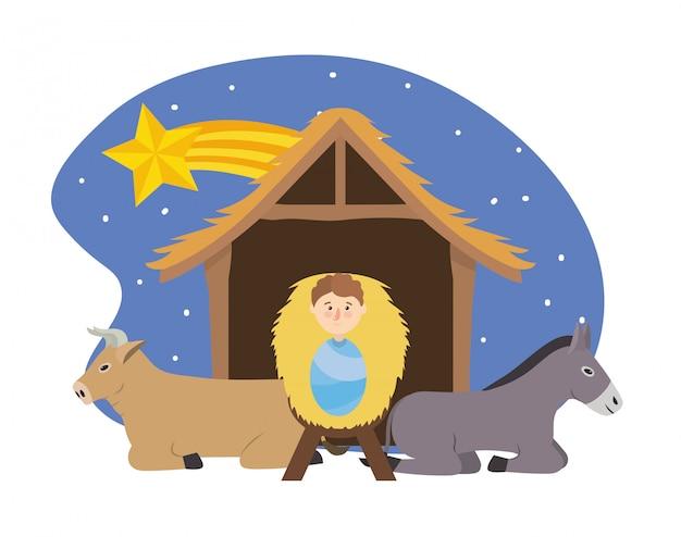 별을 가진 구유에서 당나귀와 노새 사이의 예수