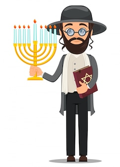 Jew man in traditional clothes with bible and menorah