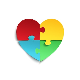 Кусочки головоломки в форме сердца, изолированные на белом