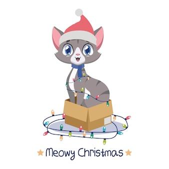 크리스마스 불빛으로 둘러싸인 골판지 상자에 앉아 유쾌한 고양이