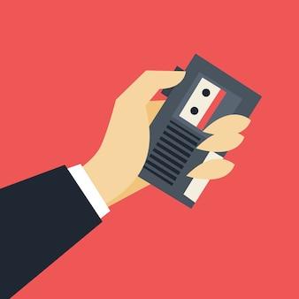 ジャーナリストのコンセプト。テープレコーダーを持っている手