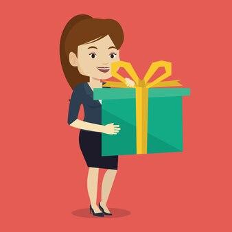 Joyful caucasian woman holding box with gift.