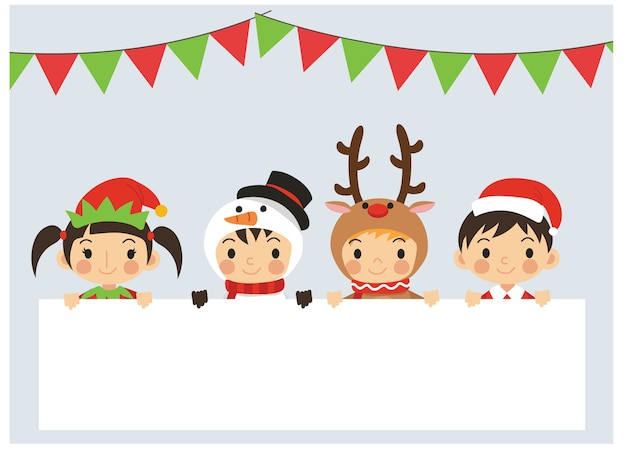 Joyful kids in variety christmas costumes are behind blank space text box. cute little christmas children.