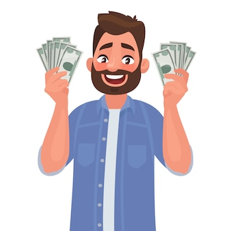 Joyful man with banknotes of money in his hands.