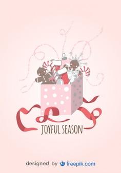Gioiosa stagione biglietto di auguri di regalo aperto con bastoncini di zucchero, calze di natale e bambole