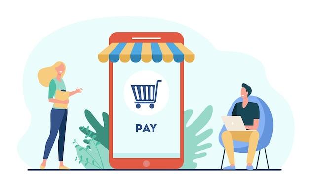 Радостные крошечные покупатели расплачиваются в интернет-магазине