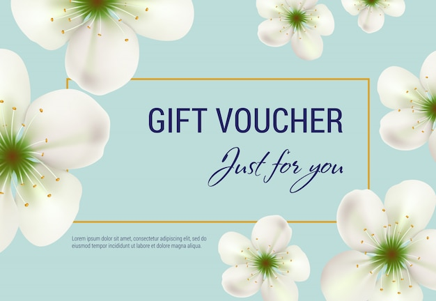 Just for you gift voucher with white blossoms and frame on light blue background.