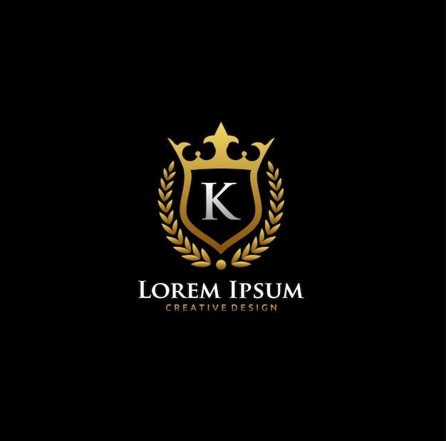 K letter gold crown logo