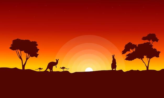 赤い空の風景シルエットとカンガルー