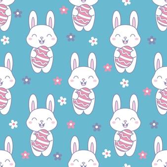 かわいいウサギとかわいいイースターシームレスパターン。