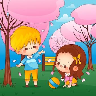 かわいい子供たちと桜が野外で遊ぶ