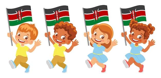 Флаг кении в руке. дети держат флаг. государственный флаг кении