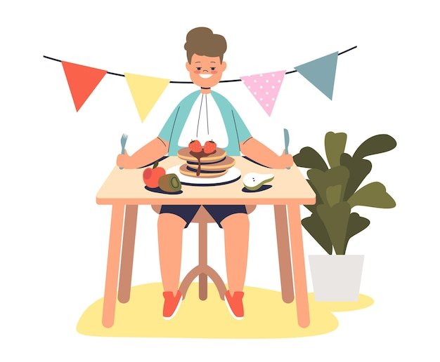 Kid boy eating pancakes, healthy breakfast meal sitting at table. small child enjoy tasty food