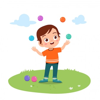 Kid boy juggling balls