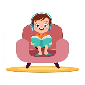 Kid boy reading in sofa