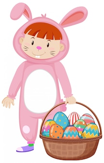 Kid in bunny costume and easter eggs in basket
