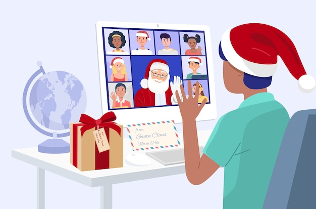 Kid having video conference on computer with santa claus and his friends at home.