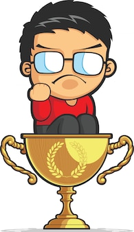 Ребенок делает успех кулаком на золотой трофей