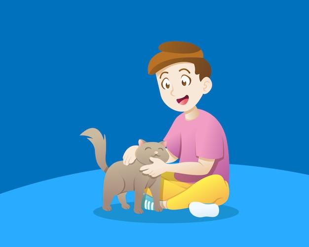 Малыш играет с кошкой
