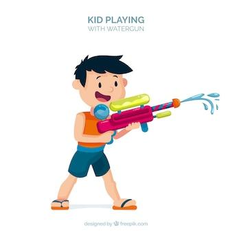カラフルなウォーターガンで遊んでいる子供