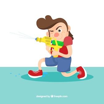 Bambino che gioca con pistola ad acqua