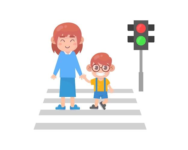 부모와 함께 길을 건너는 아이