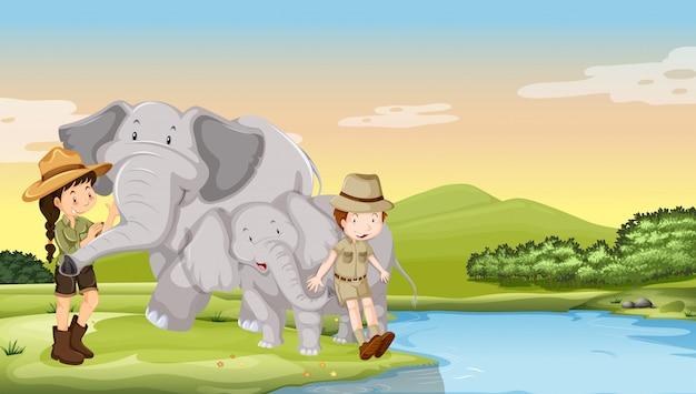 강가에있는 아이들과 코끼리