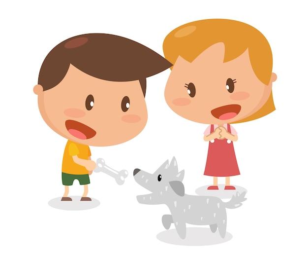 子供たちは犬に骨を与えている
