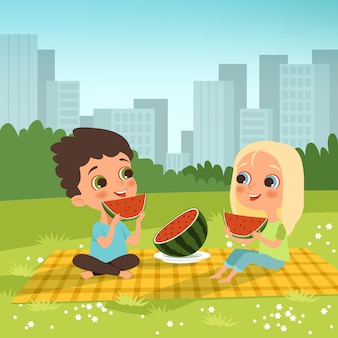 Kids couple sitting in the urban garden and eat some fruits.