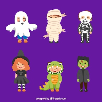 Kids dressed up in various halloween costumes