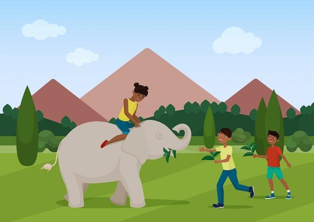 코끼리를 먹이고 타는 아이들.