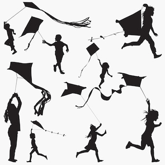 Kids flying kites silhouettes