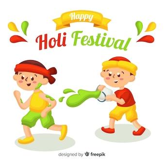 Дети веселятся на фестивале Холи