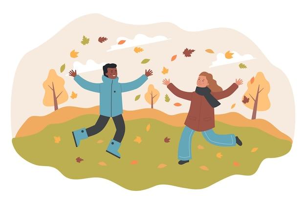 가을에 야외에서 즐거운 시간을 보내는 아이들
