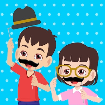 Kids having fun with props of mustache, glasses, and bowler hat greeting happy father's day