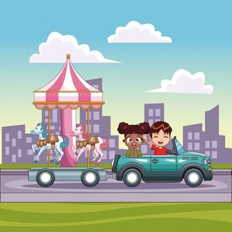 마차와 함께 회전 목마를 추진하는 차에있는 아이