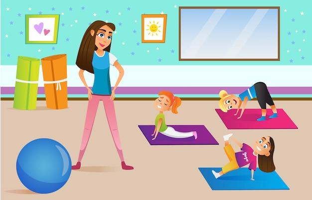 教師と体育のクラスの子供たち。