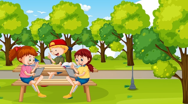 Kids leaning online with tablet in the park